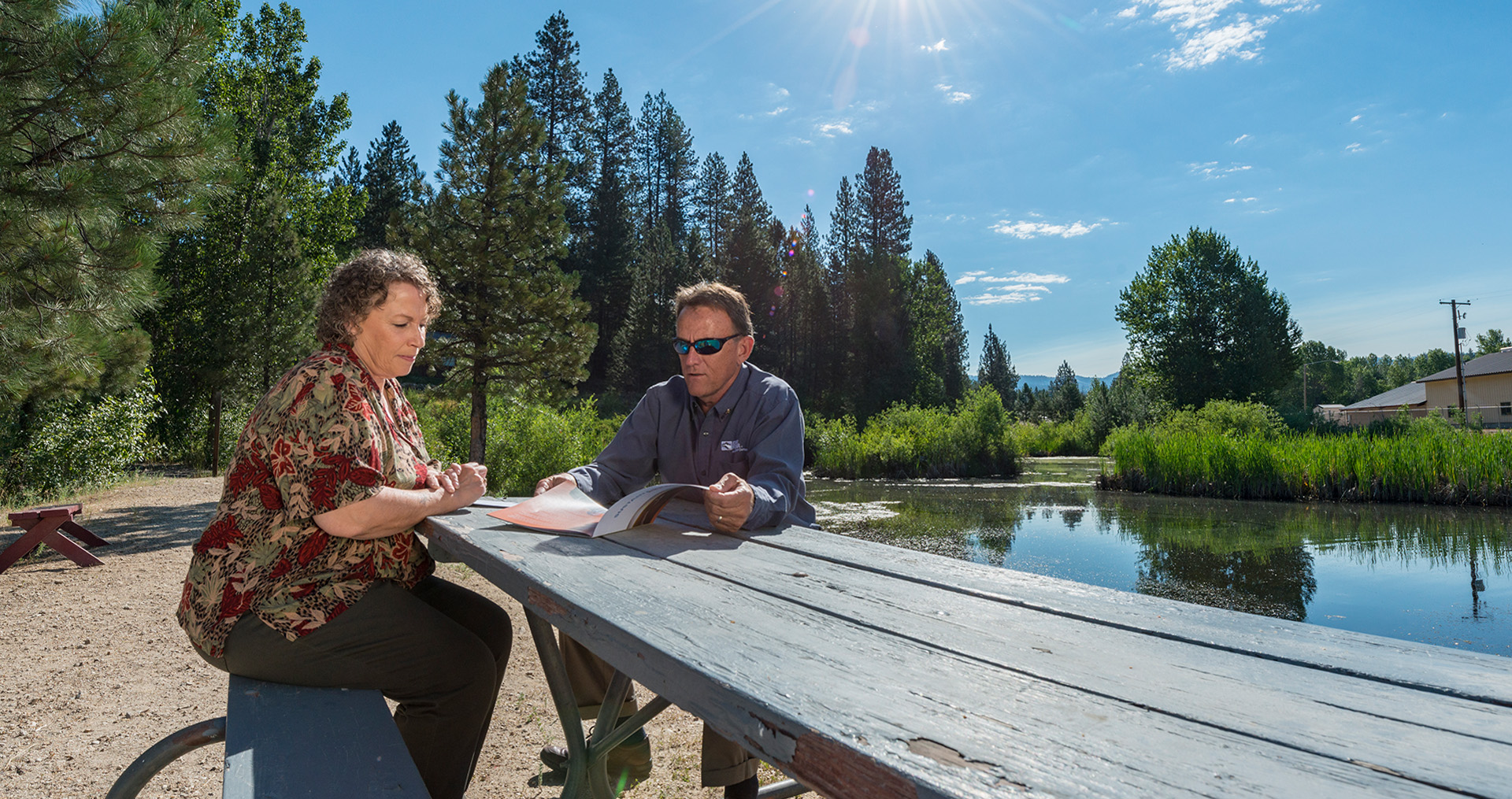 Idaho power customer speaking with an Idaho Power Representative near a river