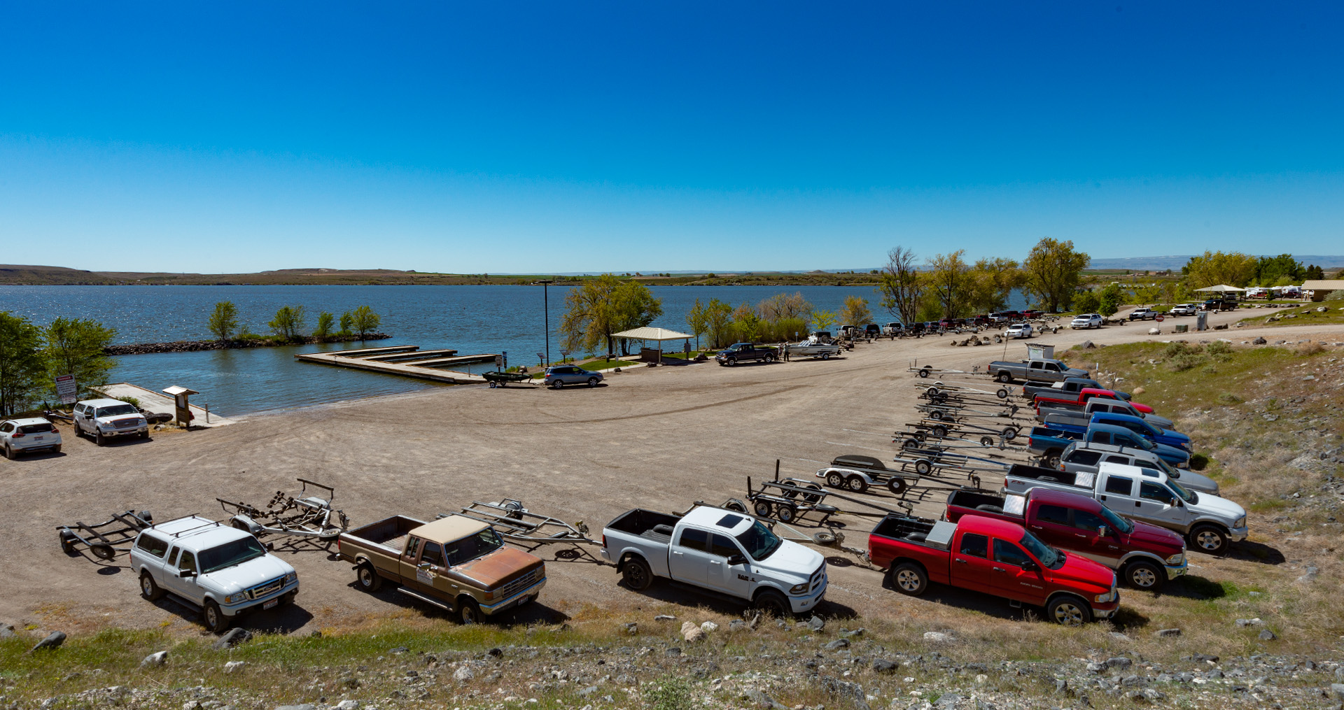 trucks and trailers parked at c.j. strike dam boat ramp