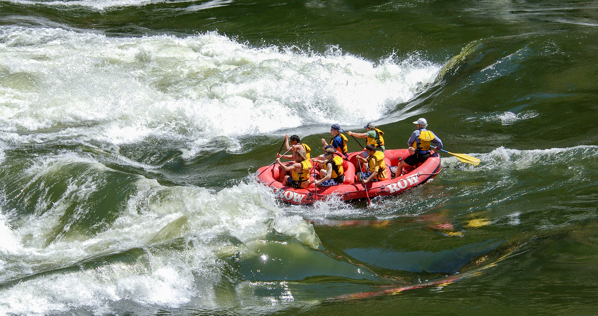 a group of people rafting through white water