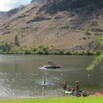 snake_river_shoreline_with_boat_people_and_boat_ramp