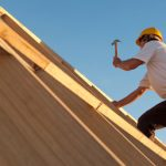 construction_worker_hammering_on_a_new_home